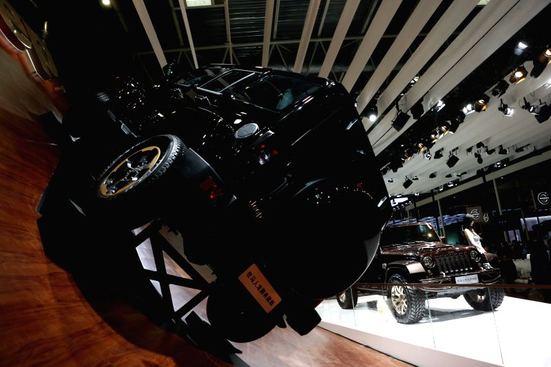 Models present an automobile during a rehearsal at the Jeep exhibition area in Beijing, capital of China, April 19, 2014. The 13th Beijing Automotive Exhibition ...