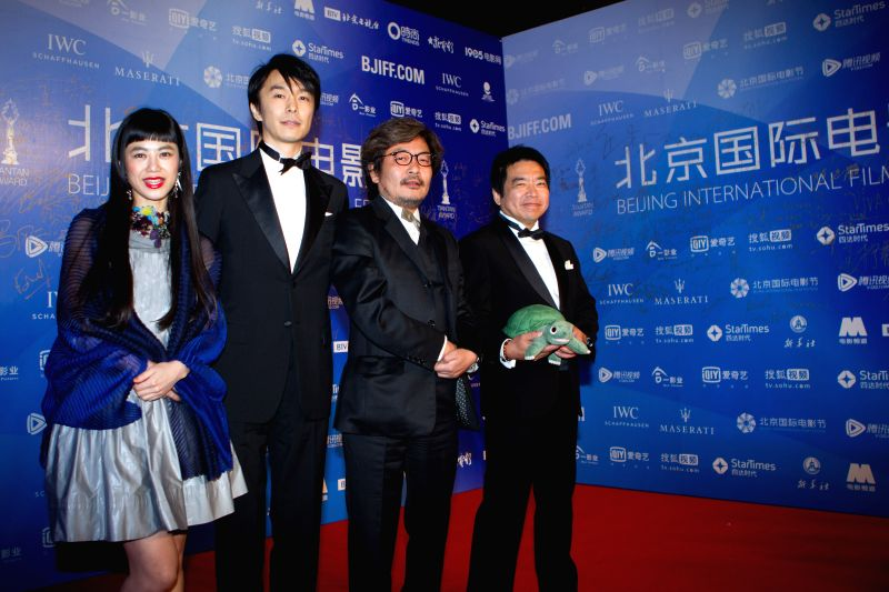 """Director Sion Sono (2nd R), leading actor Hiroki Hasegawa (2nd L) and actress Izumi Kido (1st L) attend the premiere of movie """"Love & Peace"""" during ... - Hiroki Hasegawa"""