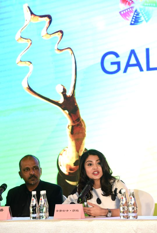 "Leading actress Anushka Sharma (R) of film ""NH10"", answers questions at a press conference during the fifth Beijing International Film Festival (BJIFF) ... - Anushka Sharma"