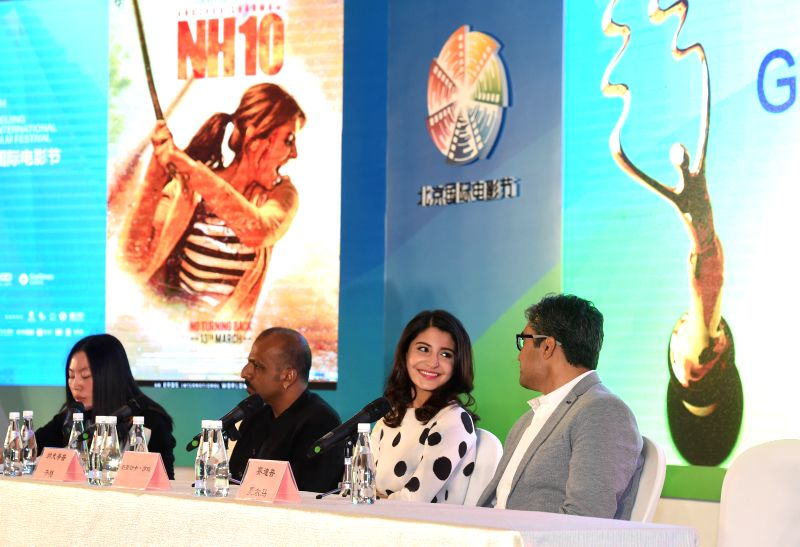 "Leading actress Anushka Sharma (2nd R) ""NH10"", talks with Director Navdeep Singh at a press conference during the fifth Beijing International Film ... - Anushka Sharma and Navdeep Singh"