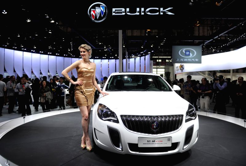 A model presents a Buick GS sedan during the media preview of the 2014 Beijing International Automotive Exhibition in Beijing, China, April 20, 2014. The auto ...