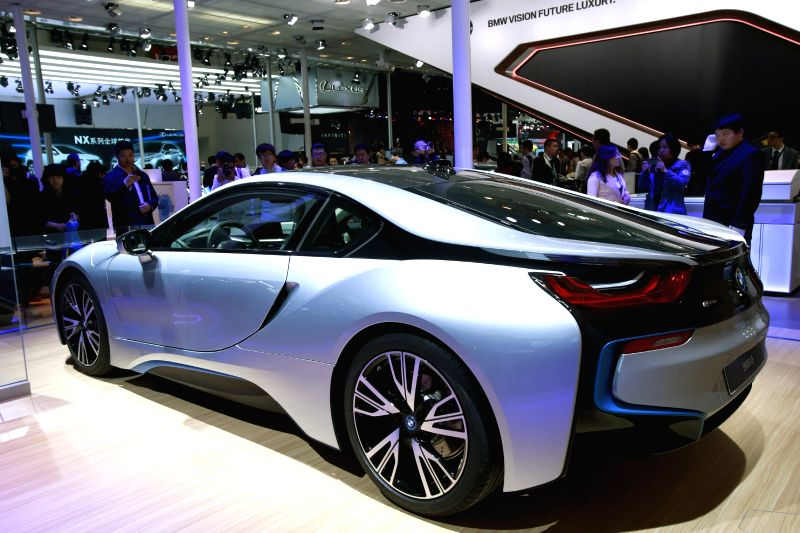 People view a BMW i8 electric car during the media preview of the 2014 Beijing International Automotive Exhibition in Beijing, China, April 20, 2014. The auto show