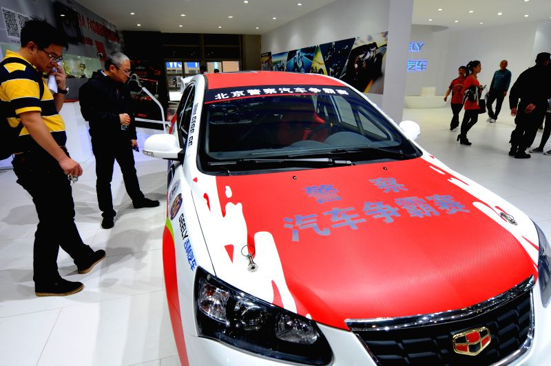 Visitors view a car during the 2014 Beijing International Automotive Exhibition in Beijing, China, April 21, 2014. The auto show will be held on April 21-29, ...