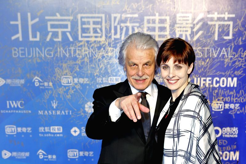 "Italian director of the movie ""The Choice"" Michele Placido (L) and producer Federica Vincenti attend the screening of the movie in Beijing, capital of ..."