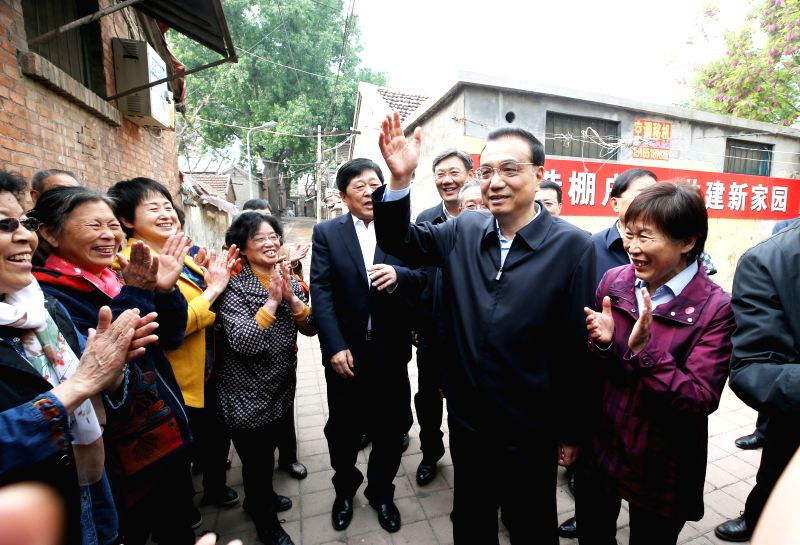 BEIJING, April 22, 2017 - Chinese Premier Li Keqiang inspects a shanty town in Jinan, capital of east China's Shandong Province, April 21, 2017. Li visited Shandong from Wednesday to Friday.