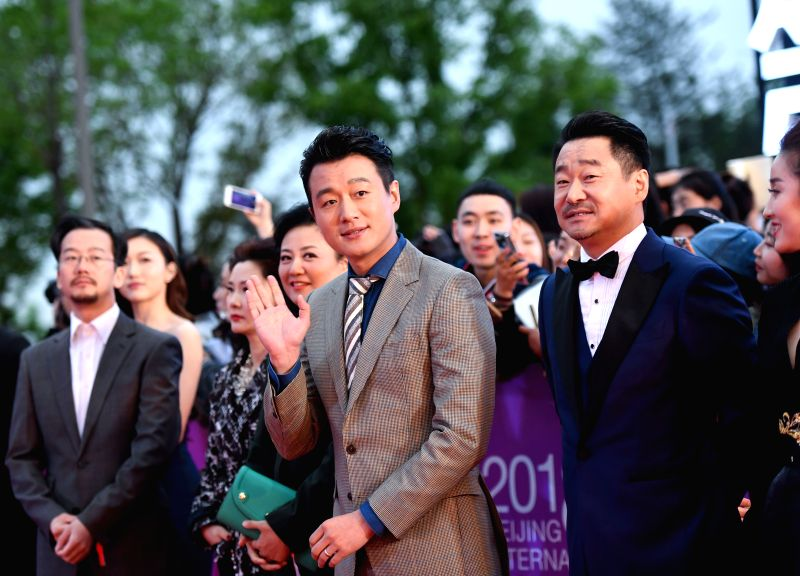 BEIJING, April 22, 2018 - Actors Tong Dawei (front, 1st L) and Wang Jingchun (front, 2nd L) pose on the red carpet for the closing ceremony of the 8th Beijing International Film Festival (BJIFF) in ... - Tong Dawei