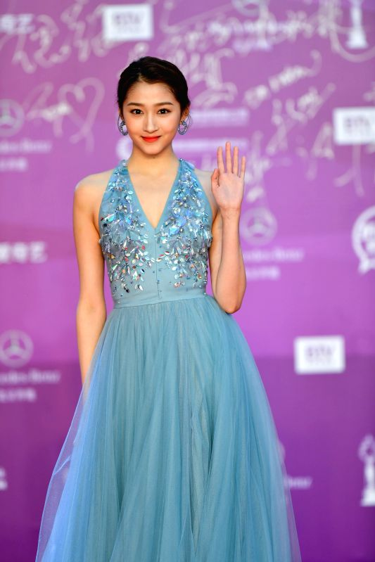 BEIJING, April 22, 2018 - Actress Guan Xiaotong poses on the red carpet for the closing ceremony of the 8th Beijing International Film Festival (BJIFF) in Beijing, capital of China, April 22, 2018. - Guan Xiaotong