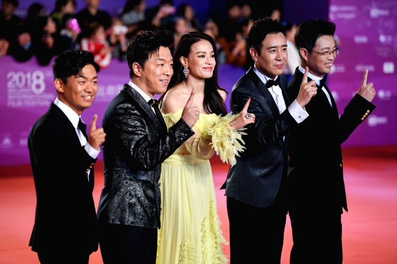 "BEIJING, April 22, 2018 - Cast members of the movie ""The Island"" pose on the red carpet for the closing ceremony of the 8th Beijing International Film Festival (BJIFF) in Beijing, capital ..."