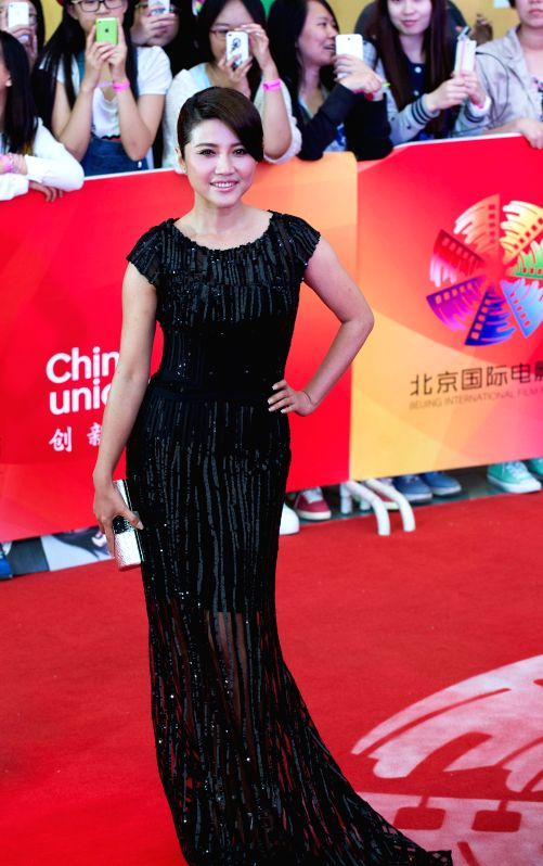 Actress Yan Bingyan poses at the red carpet during the closing ceremony of the 4th Beijing International Film Festival in Beijing, capital of China, April 23, ... - Yan Bingyan