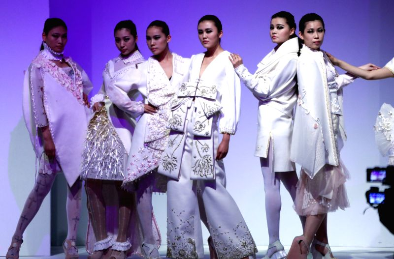 Models show creations of graduates from Northeast Dianli University in Beijing, capital of China, April 23, 2014. The China Graduate Fashion Week kicked off on ...