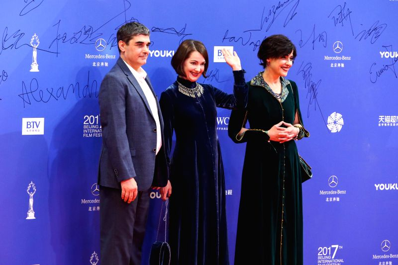 BEIJING, April 23, 2017 - Crew of the movie House of Others pose on the red carpet for the closing ceremony of the 7th Beijing International Film Festival (BJIFF) in Beijing, capital of China, April ...