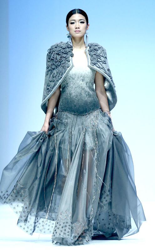 A model presents a creation designed by graduate from Wuhan-based Jianghan University during the 2014 China Graduate Fashion Week in Beijing, capital of China, ...