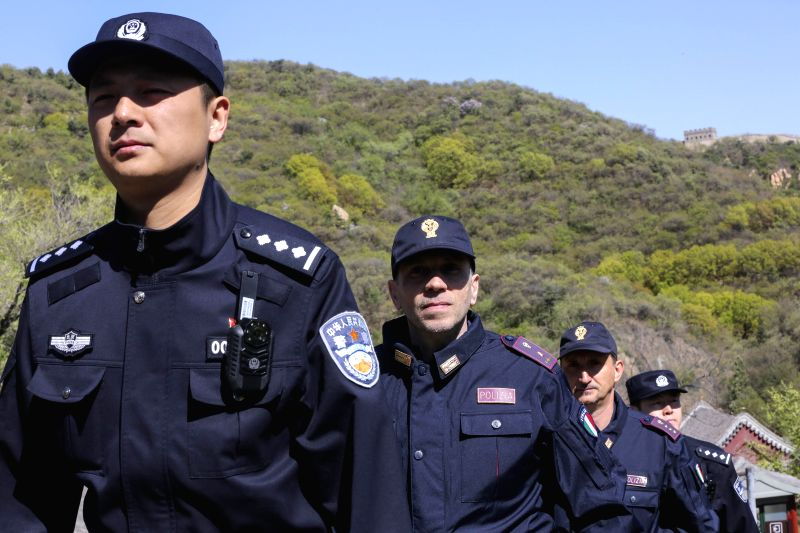 BEIJING , April 24, 2017 - Chinese and Italian policemen patrol the Badaling Great Wall in Beijing, capital of China, April 24, 2017. From April 24 to May 7, four Italian policemen together with ...