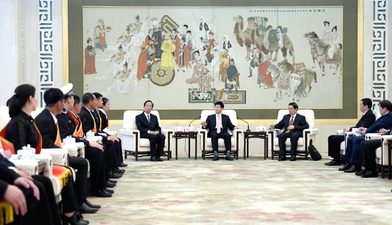 BEIJING, April 24, 2017 - Meng Jianzhu (C), head of the Commission for Political and Legal Affairs of the Communist Party of China (CPC) Central Committee, meets with representatives of people who ...