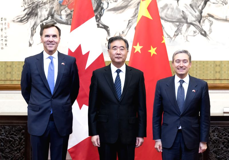 BEIJING , April 25, 2017 - Chinese Vice Premier Wang Yang (C), along with Canadian Finance Minister Morneau (L) and Canadian International Trade Minister  Champagne, launches the China-Canada ... - Morneau