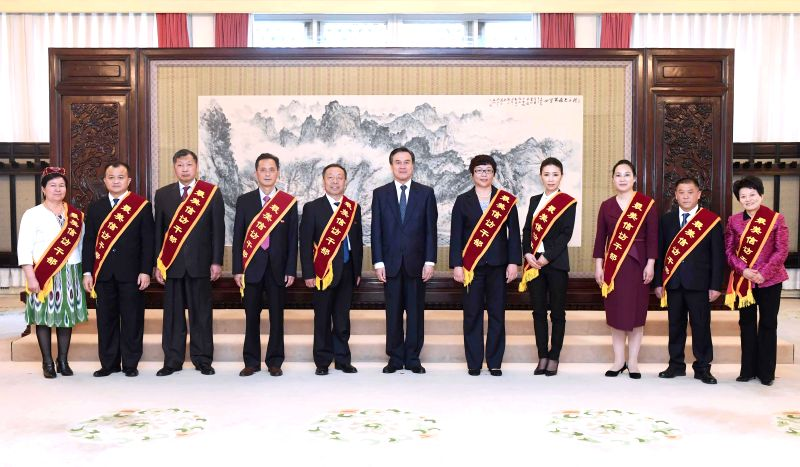 "BEIJING, April 26, 2017 - Chinese State Councilor Yang Jing (C) meets with people who won the title ""the most beautiful staff members in dealing with petition letters and calls"" in Beijing, ..."