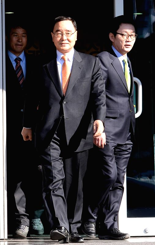 File photo taken on Feb. 8, 2013 shows Chung Hong-won walks to a press conference in Seoul, South Korea. South Korean Prime Minister Chung Hong-won resigned on ...