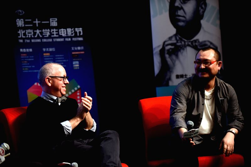 "James Schamus(L), president of the jury of the 64th Berlin International Film Festival,and Wuershan, Chinese director, attend the activity ""Face to Face with ."