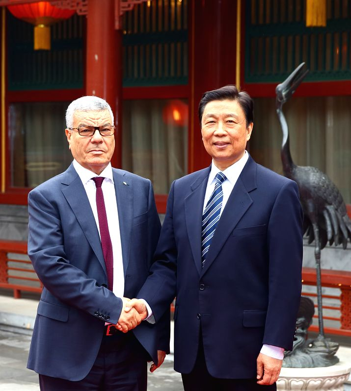 BEIJING,  April 6, 2016 - Chinese Vice President Li Yuanchao (R) meets with a delegation led by Algeria's ruling National Liberation Front (FLN) Secretary General Amar Saadani, in Beijing, capital of ...