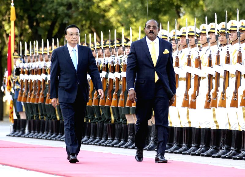 Chinese Premier Li Keqiang (L) holds a welcome ceremony for Antigua and Barbuda Prime Minister Gaston Browne in Beijing, China, Aug. 26, 2014. (Xinhua/Ding ...