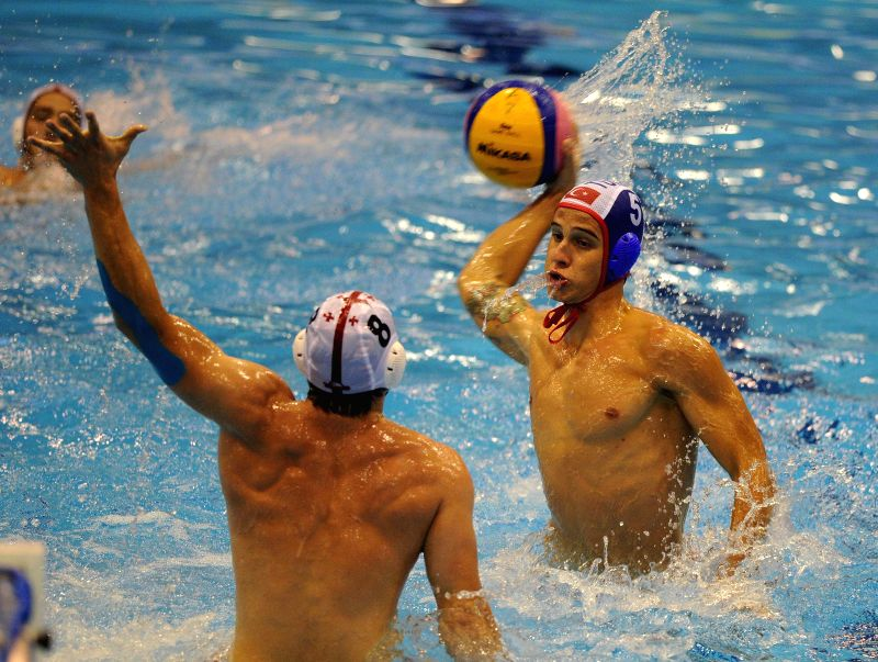 Senemenglu (R) of Turkey competes during the match between Turkey and Georgia at the Men's Under-19 European Waterpolo Championship held in Tbilisi, Georgia, on ...