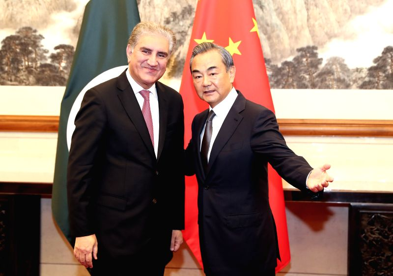 BEIJING, Aug. 9, 2019 (Xinhua) -- Chinese State Councilor and Foreign Minister Wang Yi (R) holds talks with Pakistani Foreign Minister Shah Mahmood Qureshi in Beijing, capital of China, Aug. 9, 2019. Qureshi is in China on a special and emergency vis