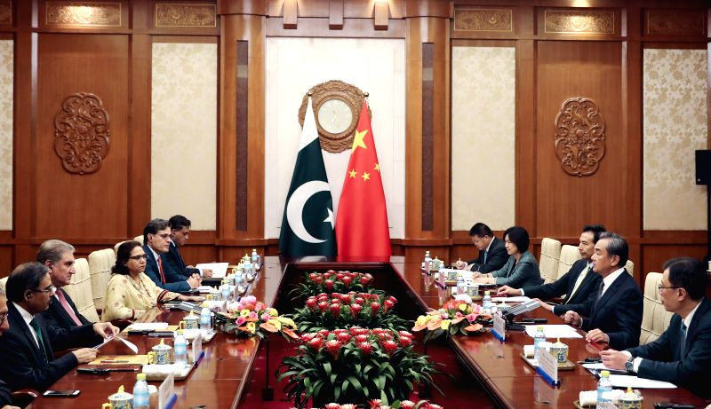BEIJING, Aug. 9, 2019 (Xinhua) -- Chinese State Councilor and Foreign Minister Wang Yi holds talks with Pakistani Foreign Minister Shah Mahmood Qureshi in Beijing, capital of China, Aug. 9, 2019. Qureshi is in China on a special and emergency visit.