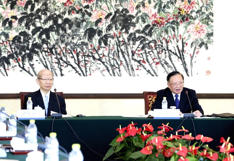 Beijing (China): Tang Jiaxuan (R), the top Chinese member of the Fifth 21st Century Committee for China-Japan Friendship, attends the plenary session of the committee with his Japanese counterpart ...