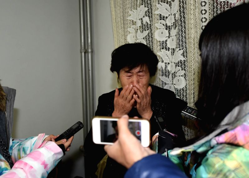 Shang Aiyun, mother of Huugjilt who was executed in a controversial 1996 rape and murder case, cries in Hohhot, capital of north China's Inner Mongolia Autonomous .