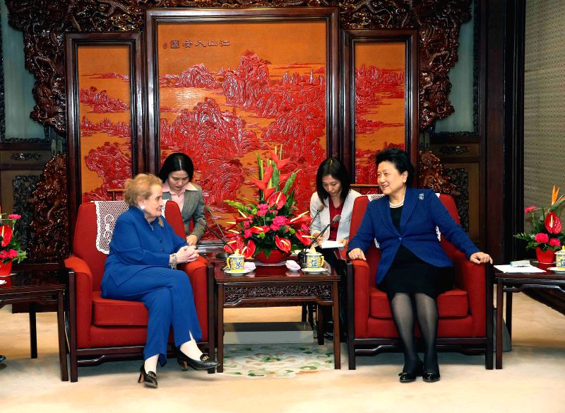 Chinese Vice Premier Liu Yandong (R) meets with former U.S. Secretary of State Madeleine Albright in Beijing, capital of China, Dec. 17, 2014. (Xinhua/Liu Weibing) .