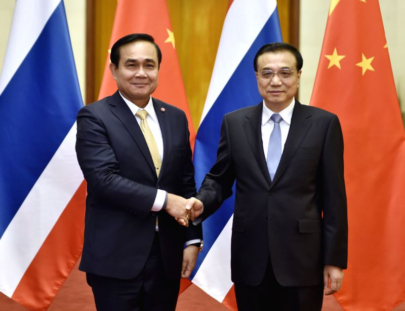Chinese Premier Li Keqiang (R) shakes hands with visiting Thai Prime Minister Prayuth Chan-ocha before their talks in Beijing, capital of China, Dec. 22, 2014. ... - Prayuth Chan
