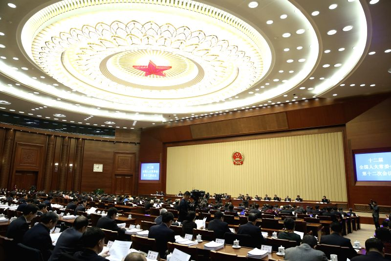 The 12th meeting of China's 12th National People's Congress (NPC) Standing Committee is held in Beijing, capital of China, Dec. 22, 2014. Zhang Dejiang, chairman of