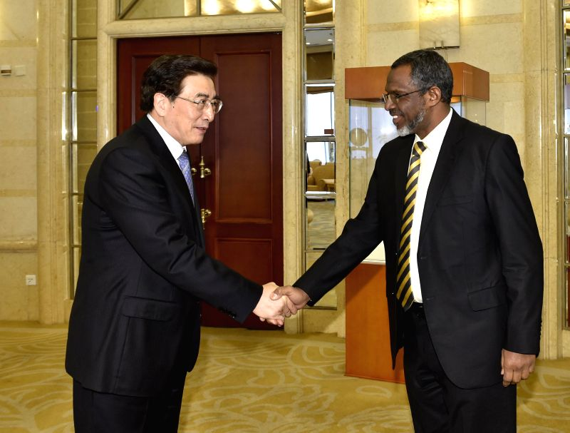 Guo Jinlong (L), a member of the Political Bureau of the CPC Central Committee and also Beijing's Party chief, shakes hands with Mutaz Musa Abdalla Salim, a leading