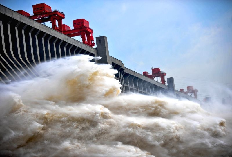 File photo taken on July 24, 2012 shows flood water discharging from the Three Gorges Dam, a gigantic hydropower project on the Yangtze River, in Yichang City, ...