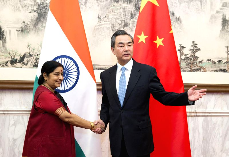 Chinese Foreign Minister Wang Yi (R) meets with his Indian counterpart Sushma Swaraj in Beijing, China, Feb. 1, 2015. - Wang Y and Sushma Swaraj
