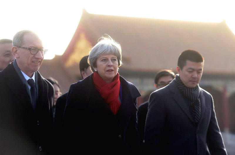 BEIJING, Feb. 1, 2018 - British Prime Minister Theresa May (C) and her husband Philip May (L) visit the Palace Museum, or the Forbidden City, in Beijing, capital of China, Feb. 1, 2018. Theresa May ... - Theresa May