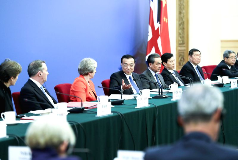 BEIJING, Feb. 1, 2018 - Chinese Premier Li Keqiang and visiting British Prime Minister Theresa May speak with representatives of entrepreneurs during the inaugural meeting of China-UK CEO Council in ... - Theresa May