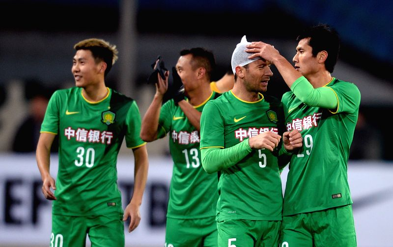 Shao  Jiayi (1st, R) of China's Beijing Guoan FC checks Matic's wound after winning the AFC Champions League football match against Thailand's Bangkok Glass FC in ..