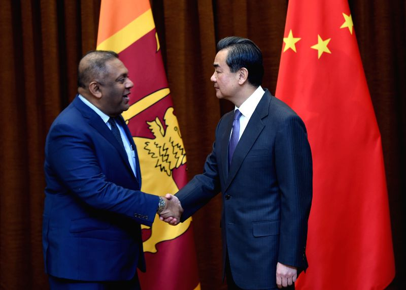 Chinese Foreign Minister Wang Yi (R) meets with Sri Lankan Foreign Minister Mangala Samaraweera in Beijing, capital of China, Feb. 27, 2015.