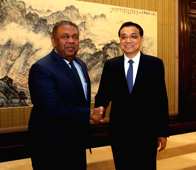 Chinese Premier Li Keqiang (R) meets with Sri Lankan Foreign Minister Mangala Samaraweera in Beijing, capital of China, Feb. 27, 2015. - Mangala Samaraweera