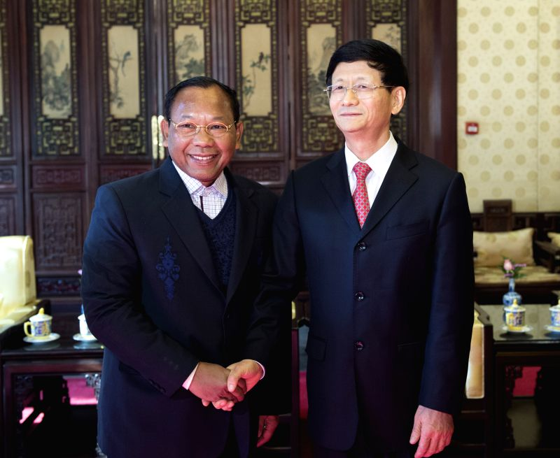 Meng Jianzhu(R), head of the Commission for Political and Legal Affairs of the Communist Party of China (CPC) Central Committee, meets with Saud Usman Nasution, ...