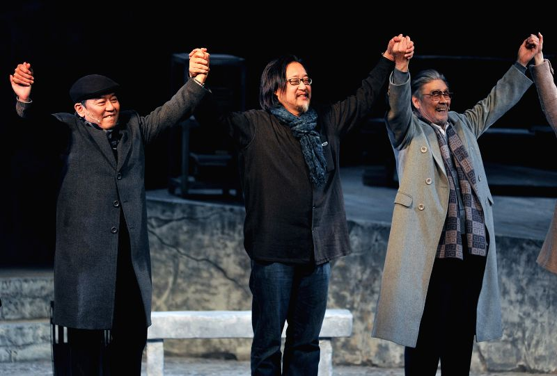 """Stan Lai (C) of southeast China's Taiwan, director of drama """"Die Winterreise""""(The Winter Journey), together with major actors Lee Li-Chun (L) and Lan ... - Lee L"""