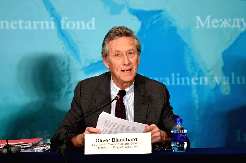 Olivier Blanchard, IMF economic counsellor and director of the Research Department, attends a press briefing on the World Economic Outlook in Beijing, capital of ...