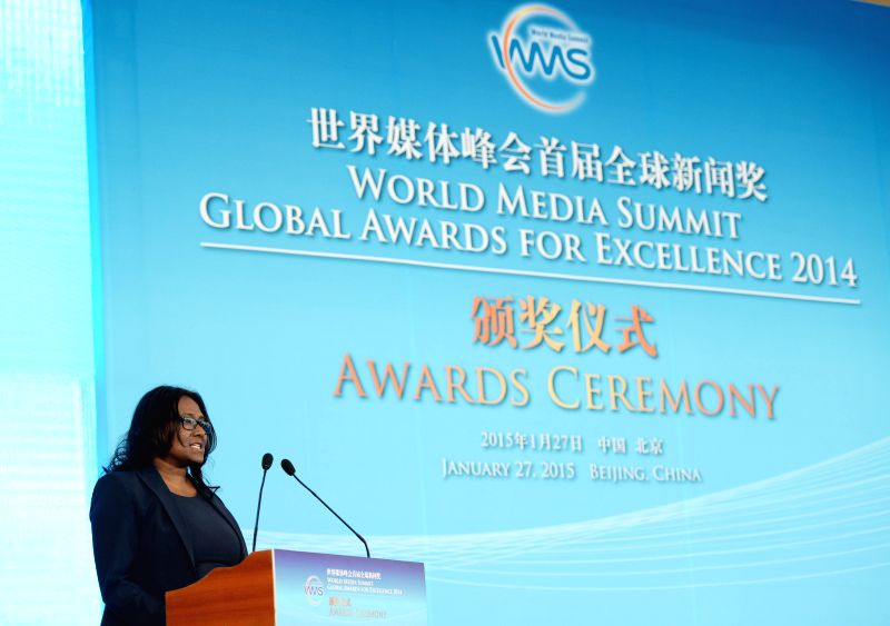 Daisy Veerasingham, senior vice president of the Associated Press, addresses the awarding ceremony of the World Media Summit (WMS) Global Awards for Excellence 2014