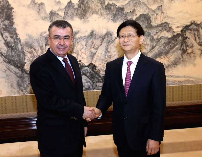 Meng Jianzhu (R), head of the Commission for Political and Legal Affairs of the Communist Party of China (CPC) Central Committee, meets with Mehmet Celalettin ...