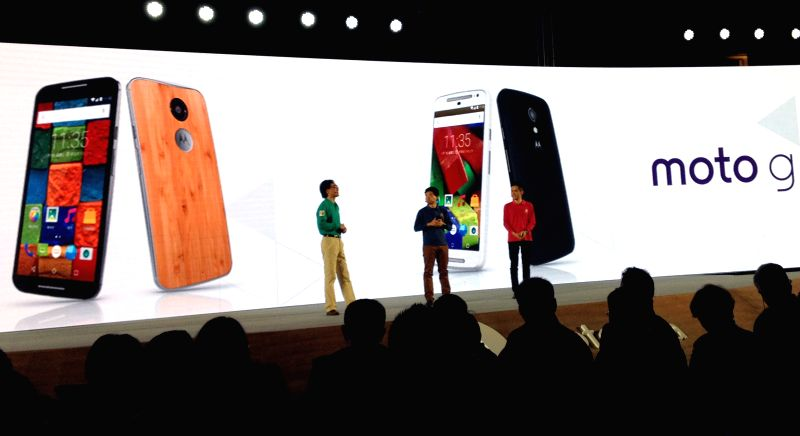Motorola holds a news conference for its new products in Beijing, capital of China, Jan. 26, 2015. Motorola on Monday returned to the Chinese market by releasing ...
