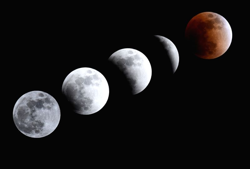 BEIJING, Jan. 31, 2018 - Combo photo taken on Jan. 31, 2018 shows different shapes of the moon during a total lunar eclipse in Beijing, capital of China, Jan. 31, 2018. A red moon will grace the sky ...