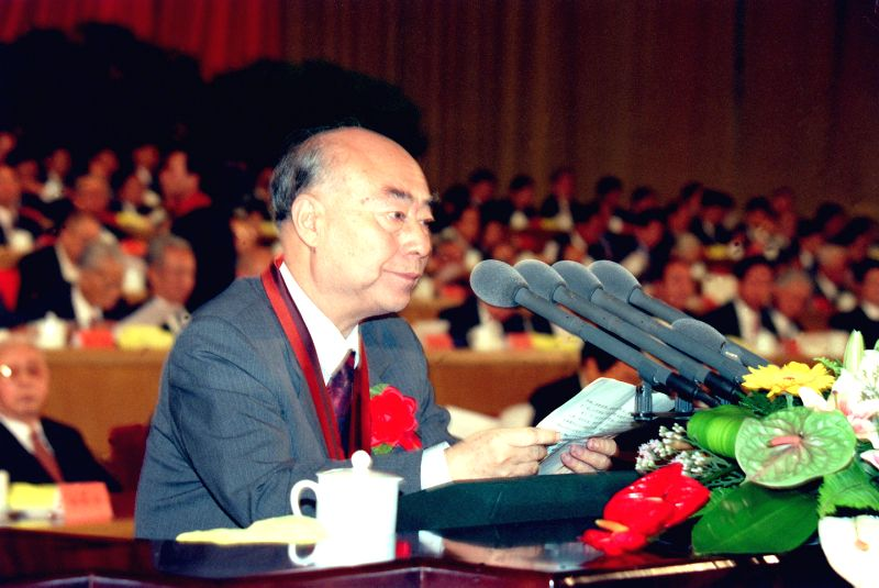 File photo taken on Sept. 18, 1999 shows Chinese nuclear physicist Yu Min making a speech at a convention. China held a convention on Jan. 9, 2015 to present the ...