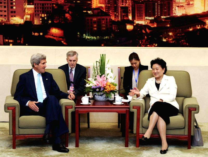 Chinese Vice Premier Liu Yandong (R) meets with U.S. Secretary of State John Kerry after they jointly hosted the Fifth Round of the China-U.S. High-Level ...