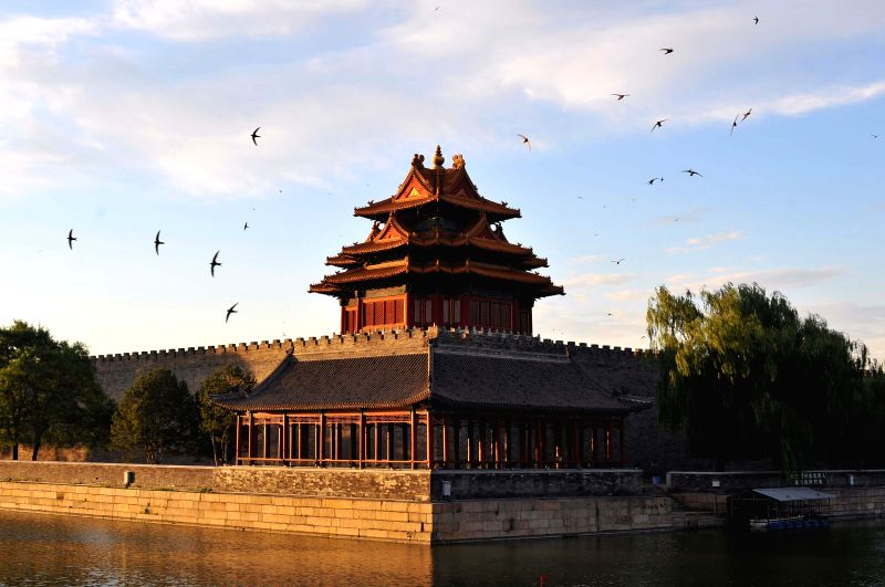 Photo taken in the early morning on July 12, 2014 shows a watchtower of the Palace Museum, also known as the Forbidden City, in Beijing, capital of China.